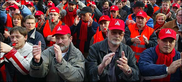 Employees of German car manufacturer Volkswagen AG gather during a warning strike