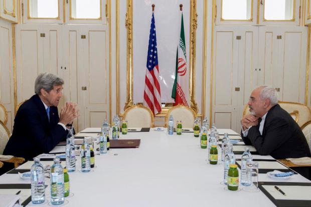 U.S. Secretary of State John Kerry (L)  meets with Iranian Foreign Minister Javad Zarif at a hotel in Vienna, Austria June 30, 2015.  Kerry and  Zarif held a