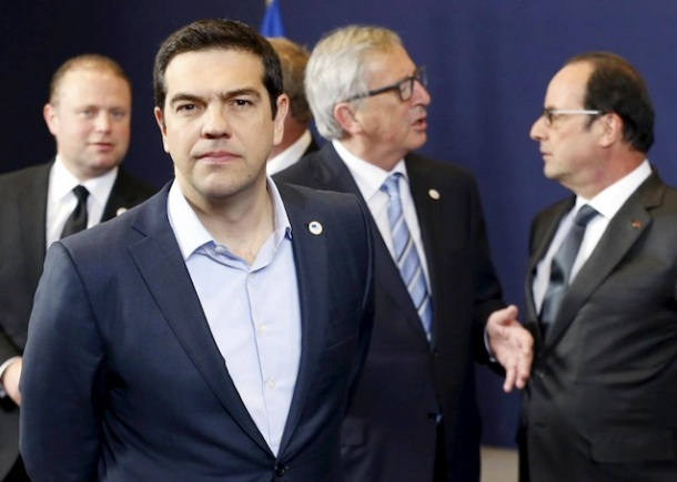 Greece's Prime Minister Alexis Tsipras leaves a family photo next to (back L-R) Malta's Prime Minister Joseph Muscat, European Commission President Jean-Claude Juncker and France's President Francois Hollande during a European Union leaders summit in Brussels April 23, 2015. European Union leaders who decided last year to halt the rescue of migrants trying to cross the Mediterranean will reverse their decision on Thursday at a summit hastily convened after nearly 2,000 people died at sea.   REUTERS/Francois Lenoir